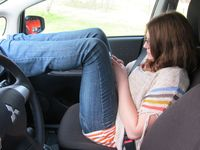 Layne Sharpe demonstrates an unsafe way to sit in a vehicle