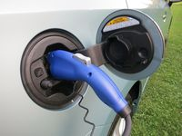 The Toyota Prius Plug-In charges from a wall outlet