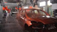 Cars go through the paint shop at Ford's factory - photo courtesy Ford Motor Company