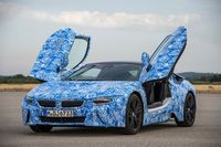 The BMW i8, shown as a disguised pre-production model, features scissor-style doors - photo courtesy BMW