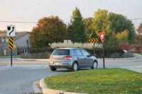 A driver prepares to enter a traffic circle - photo by Jil McIntosh