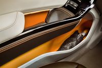 Small-item storage is an essential part of a car's design - photo courtesy Johnson Controls (2)