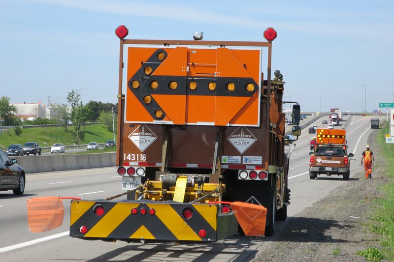 Highway Debris- A crash truck protects a cleanup crew picking up a shredded tire - photo by Jil McIntosh - for Wheels