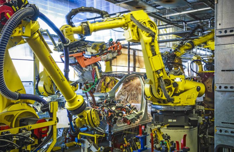 Robots bond panels using adhesives - Photo courtesy General Motors